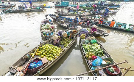 Can Tho, Vietnam - January 22, 2017: View above farmers purchase crowded in floating market with dozens boats along river trade agricultural products serves traditional New Year in Can Tho, Vietnam