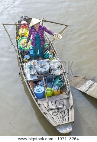Can Tho, Vietnam - January 22, 2017: Food vendor selling noodles on the boat serving farmers in agricultural trade floating market in Can Tho, Vietnam