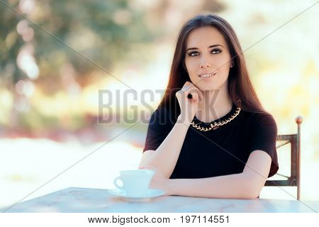 Beautiful Woman with Statement Necklace Having a Cup of Coffee