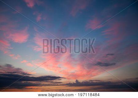 Romantic sunset sunrise sky with romantic rose clouds