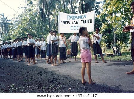 PATAMEA, SAVAI'I / SAMOA - CIRCA 1990: The Patamea Christian Youth parade on a tar sealed road in Patamea.