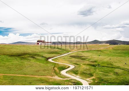 View on tradtitional tibetan monastery by Tagong grassland in China