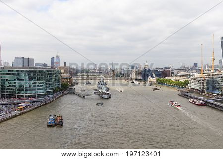 LONDON UNITED KINGDOM - JUNE 22 2017: Modern office buildings in London view from Tower Bridge London United Kingdom. As of 2017 there are 17 skyscrapers in London that reach a roof height of at least 150 meters