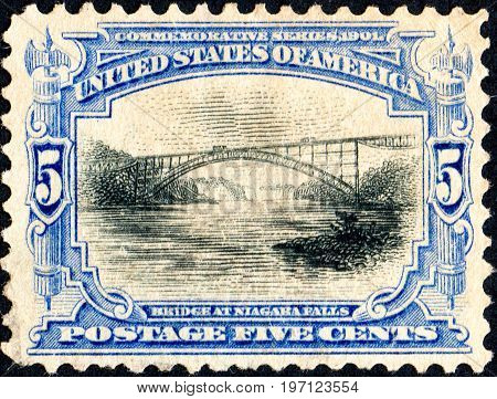 UKRAINE - CIRCA 2017: A postage stamp printed in USA United States of America shows Whirlpool Rapids Bridge 1897 Niagara Falls from series Pan-American Exposition Issue circa 1901