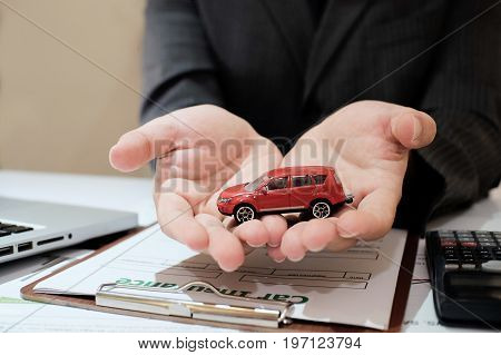 A Man Insurance broker offer protect your car Insurance auto car concept and Insurance reimbursement vehicle Concept