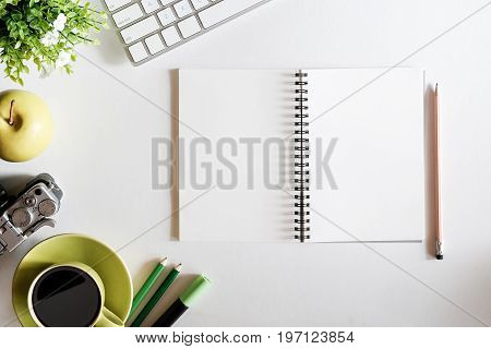 View from above with copy work space office accessories with business objects on white table office.Copy space for text or products display montage.