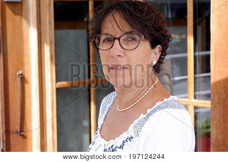 Portrait of a middle-aged brunette woman with eyeglasses outdoor