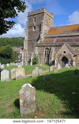 All Saints Church with tombs in the foreground in Hastings, UK