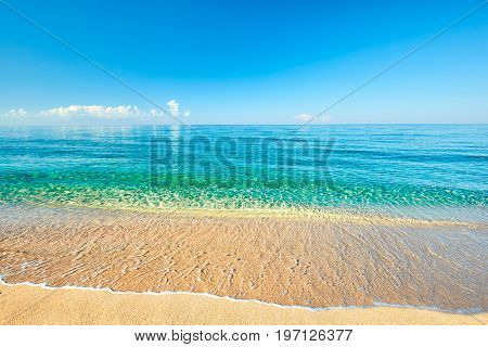 Sea view from tropical beach with sunny sky. Summer paradise beach. Tropical shore. Tropical sea. Exotic summer beach with clouds on horizon. Ocean beach relax outdoor travel