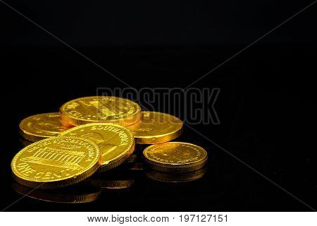 a pile of (chocolate candies) gold coins symbolizing growing wealth