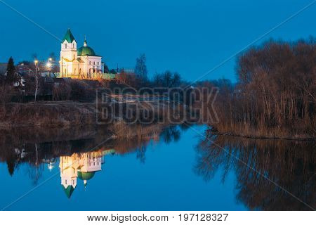 Gomel, Belarus. Church Of St Nicholas The Wonderworker In Lighting At Evening Or Night Illumination. Landscape With Orthodox Church Of St. Nikolaya Chudotvortsa, Reflection In Sozh River
