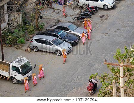 Buddhist Nuns Walking In Mandalay, Myanmar