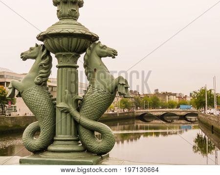 DUBLIN, IRELAND - NOVEMBER 06, 2013: Ha Penny Bridge. Pedestrian cast-iron bridge, symbol of the Dublin. Selective focus