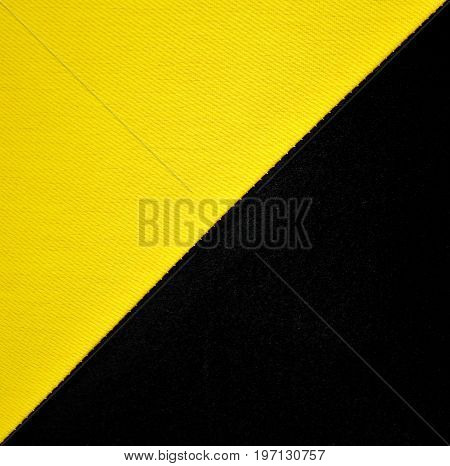 Yellow and black natural linen fabric texture background. Grid pattern canvas texture. Symbol of anarchy in trade. Color block background. Black and yellow flag is used by various market anarchists