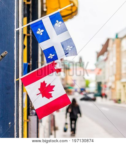 Quebec City, Canada - May 29, 2017: Closeup Of Two Small Canadian And Quebec Flags Hanging On Restau