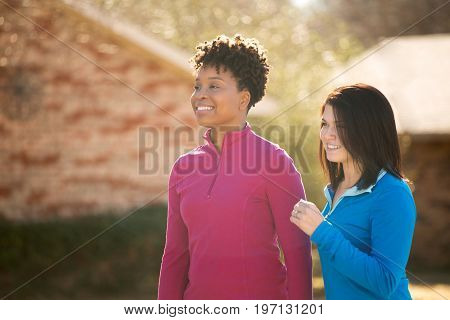 Diverse group of women getting fit walking and talking.
