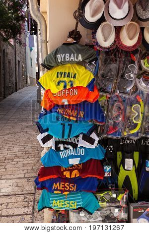 POREC CROATIA - JULY 14: Soccer shirts hang outside a shop on July 14 2017