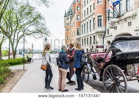 Quebec City, Canada - May 29, 2017: Old Town Street With View Of Hotel Chateau Frontenac And Tour Gu