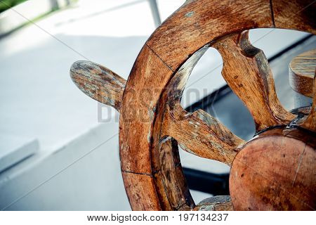 Wooden and Vintage old Steering wheel Handwheel ship close up