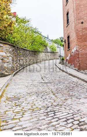 Quebec City, Canada - May 30, 2017: Lower Old Town Narrow Street With Cobblestone Road On Incline Up