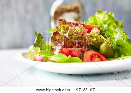 Healthy salad with tomatoes and olives