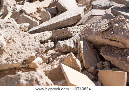 Concrete rubble debris on construction site background for graphic design.