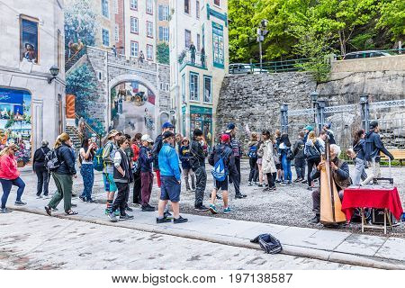 Quebec City, Canada - May 30, 2017: Lower Old Town Street With Parc De La Cetiere And People Listeni