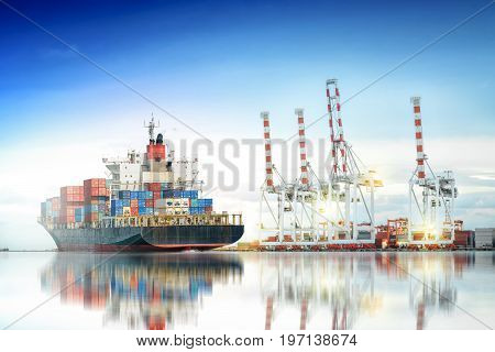 Logistics and transportation of International Container Cargo ship in a harbor with water reflections for logistic import export background and transport industry.