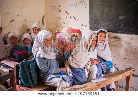 SKARDU, PAKISTAN - APRIL 18: unidentified Children in a village in the south of Skardu are learning in the classroom of the village school April 18, 2015 in Skardu, Pakistan.