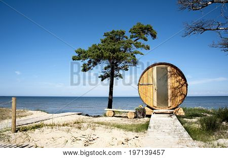 Europe Latvia Cape Kolka. House in the form of a barrel on the dunes for a double stay at the coast of the Baltic Sea. View from the door side.