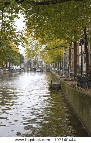 Amsterdam, Netherlands, October 2016, Canal on Amstel river wide angle - vertical