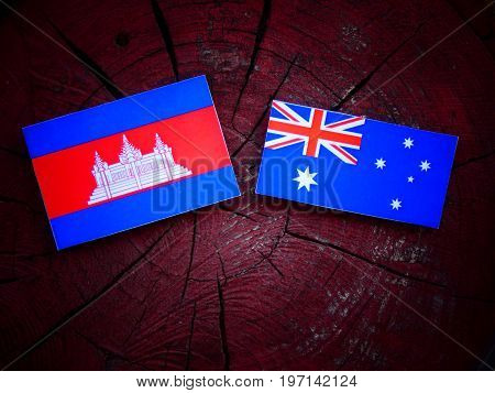 Cambodian Flag With Australian Flag On A Tree Stump Isolated