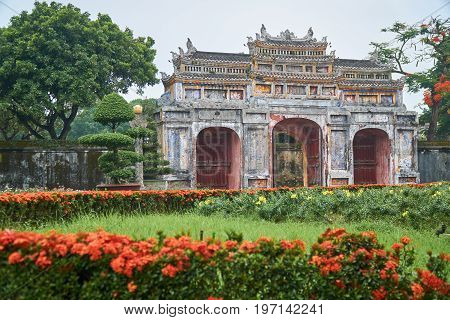 Gate, Plants, flowers and trees in the mist. Park in the imperial city in vietnam