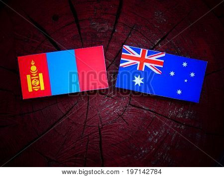 Mongolian Flag With Australian Flag On A Tree Stump Isolated