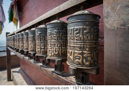 The bronze prayer wheel in Swayambhunath temple in Kathmandu the capital cities of Nepal.