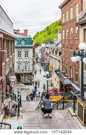 Quebec City Canada - May 30 2017: Lower old town streets called Rue du Petit Champlain and Sous Fort with people tourists walking by restaurants