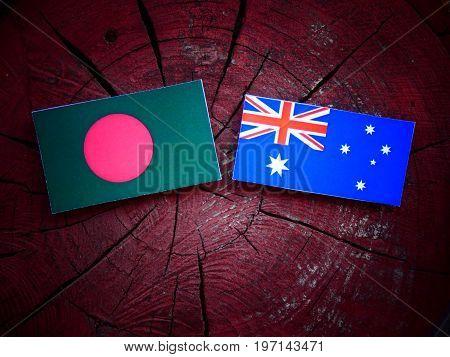 Bangladesh Flag With Australian Flag On A Tree Stump Isolated