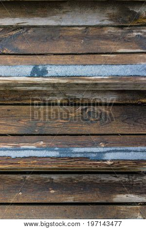 Macro Closeup Of Wet, Wooden Stairs Or Steps With Blue No-slip Strips