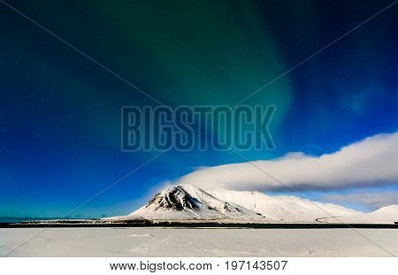 Mountain with Aurora borealis Stokksnes in Iceland