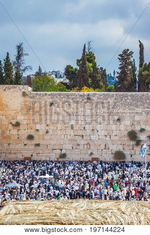 Autumn holiday of Sukkot in Jerusalem. Western Wall of the Temple. The huge crowd of Jews for a prayer has gathered on the square