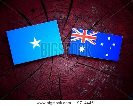 Somalian Flag With Australian Flag On A Tree Stump Isolated