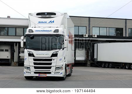 SALO FINLAND - JUNE 18 2017: White Next Generation Scania R580 truck regfrigerated trailer of Makela Oy on the loading zone of a warehouse.