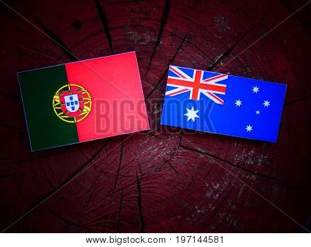 Portuguese Flag With Australian Flag On A Tree Stump Isolated