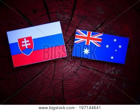 Slovakian Flag With Australian Flag On A Tree Stump Isolated