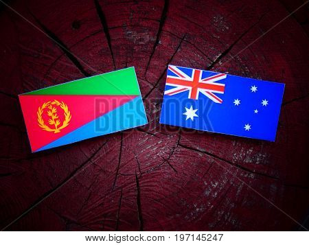 Eritrean Flag With Australian Flag On A Tree Stump Isolated