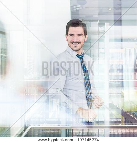 Relaxed cheerful team leader and business owner leading informal in-house business meeting. Business and entrepreneurship concept. Corporate office building seen in glass reflections.