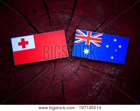 Tongan Flag With Australian Flag On A Tree Stump Isolated