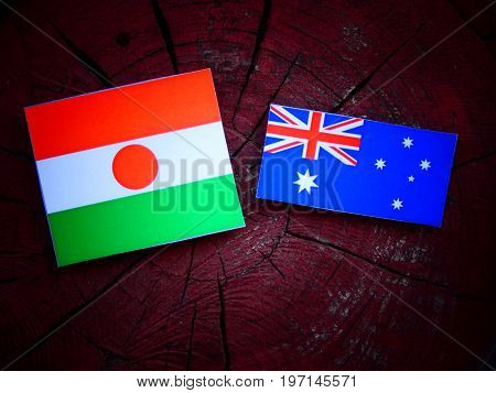Niger Flag With Australian Flag On A Tree Stump Isolated