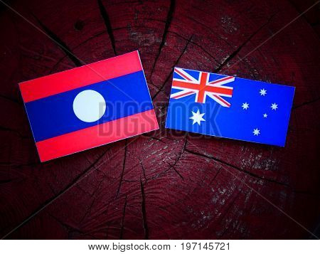 Laos Flag With Australian Flag On A Tree Stump Isolated