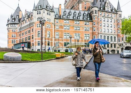 Quebec City, Canada - May 30, 2017: Old Town Street And View Of Hotel Chateau Frontenac With Women W
